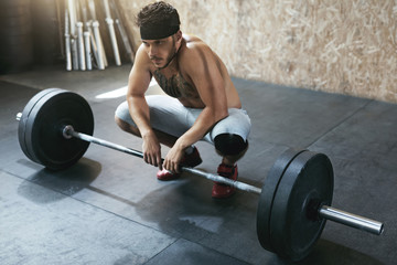 Sportsman Training With Barbell Row At Crossfit Gym
