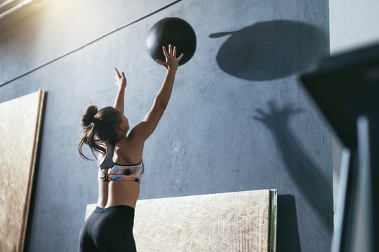 Workout. Sport Woman Training With Crossfit Ball At Gym
