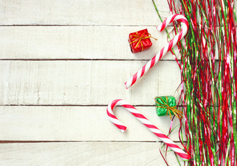 New Year, Christmas background, green and red tinsel, striped lollipop, gift box