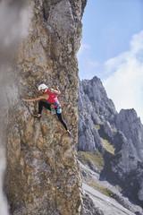 Austria, Innsbruck, Nordkette, woman climbing in rock wall