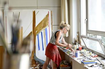 Female painter in her atelier