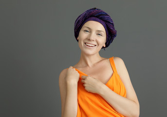 Woman after chemotherapy on grey background