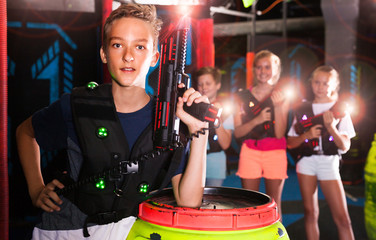Boy with laser pistol in laser tag labyrinth