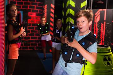 Boy having fun on lasertag arena