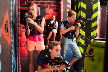 Teenagers having fun on lasertag arena