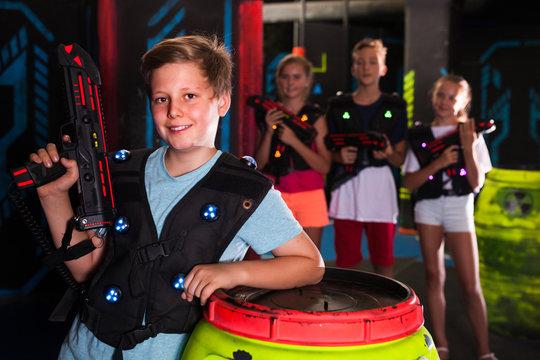 Boy with laser gun on lasertag arena