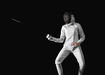 Young female fencer on dark background