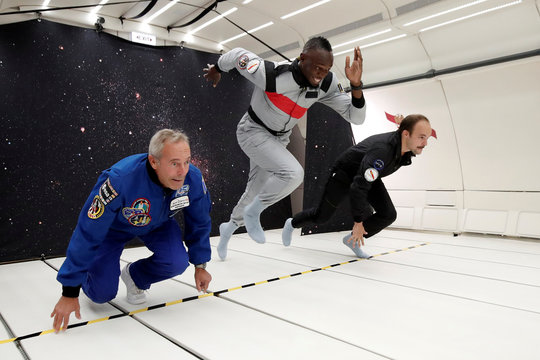 Retired sprinter Usain Bolt, French astronaut Jean-Francois Clervoy and French Interior designer Octave de Gaulle enjoy zero gravity conditions during a flight in a specially modified plane above Reims