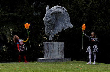 """Dancers perform next to a  sculpture entitled """"Into the Wind"""" by Nic Fiddian-Green during the Chatsworth Outdoors exhibition at Chatsworth House near Edensor"""