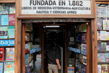 Employee enters Madrid's oldest bookstore Libreria Nicolas Moya in central Madrid