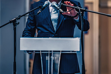 Male Speaker On The Stage