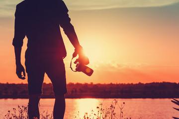 Sunset Photography,Photographer holding camera
