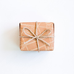 Vintage style brown gift box on white background