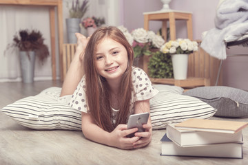 Adorable little girl take learning social media on phone in the living room, daughter on FaceTime with family on mobile