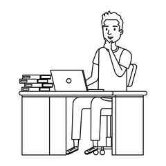 young man at desk with laptop and books