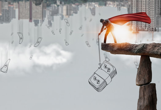 Concept of Crisis recovery for economy and financial institutions, Superhero businessman Standing on cliff.