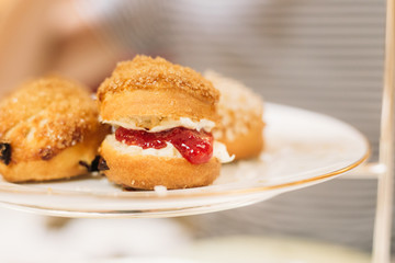 Scones with Strawberry Champagne Jam and Clotted Cream, Traditional English Tea Ceremony in Luxury Hotel