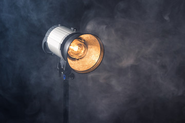 Close-up of a professional lighting fixture on a set or photographic studio. Concept of shooting a movie