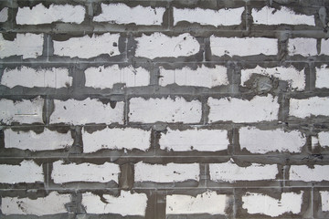Background texture of wall from white lightweight foamed brick with cement adhesive