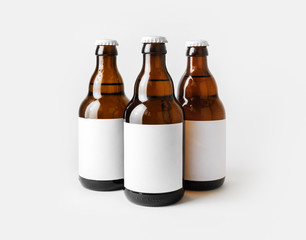 Papiers peints Biere, Cidre Three glass brown beer bottles with with blank labels.