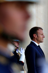 French President Emmanuel Macron welcomes Swiss President Alain Berset as he arrives for a meeting at the Elysee Palace in Paris
