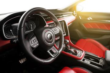 Car interior steering wheel partial close-up