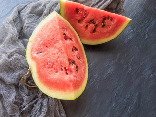 ripe red watermelon on a dark background Summer food background healthy eating. eco-friendly products. organic fruits. copyspace. Organic Food. Top View