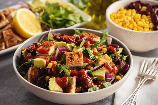 Chicken salad with avocado, corn and bean.