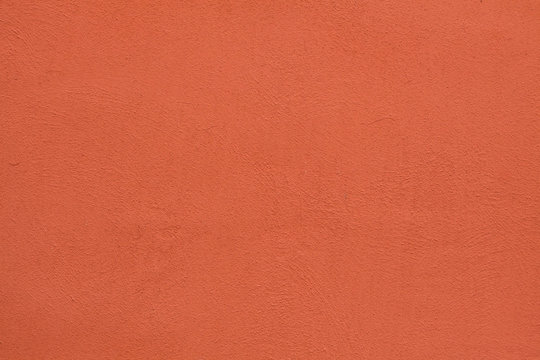 Orange painted stucco wall. Background texture