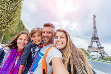 Happy family having fun together in Paris near the Eiffel tower