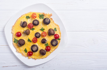 Omelette with mushroom , tomato and parsley