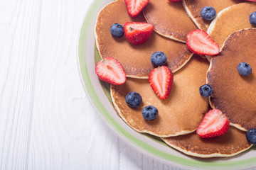 Pancakes with strawberry and blueberry