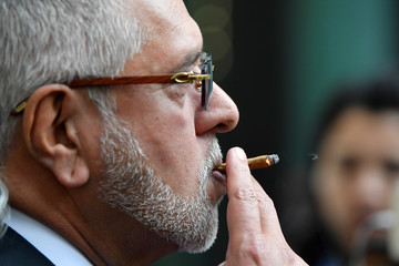 Vijay Mallya smokes outside Westminster Magistrates Court in London