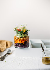 Salad in glass jar with chickpea