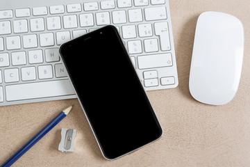 Modern smartphone on a keyboard