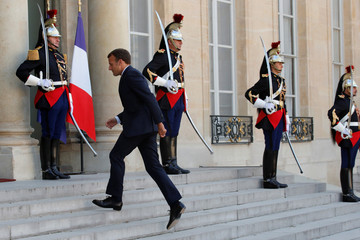 French President Emmanuel Macron walks back to his office at  the Elysee Palace in Paris