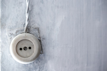 old electrical outlet on the wall