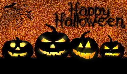 vier Halloweenkürbisse mit gruseligen Gesichtern