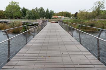 wooden bridge over the river Tidan in Mariestad city center