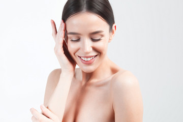 Young beautiful woman with clean perfect skin closeup