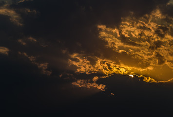 Sunset against the background of clouds