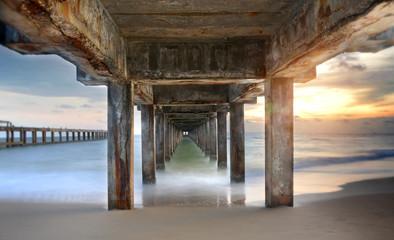 Under old concrete bridge