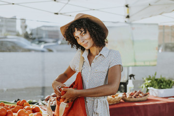Woman buying tomatoes at a farmers market