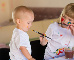 Boy and girl, painted, white t-shirt, fun