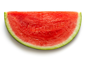 Slice of seedless watermelon isolated on white from above.