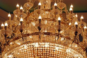 Baroque chandelier. Rlegant luxury chandelier on the ceiling of a luxury restaurant.