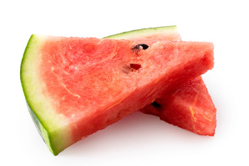 Two lying watermelon triangles with seeds  isolated on white.