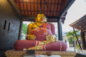 sitting statue of fat Buddha in Wat Chedi Luang most important temples is the Wat Chedi Luang located in the .ancient walled part of the city.