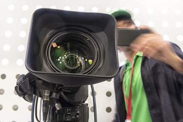 Professional tv camera in live show pavilion.