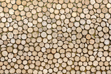 Wood texture background made of stacked wood logs